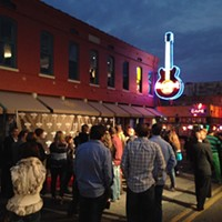 Hard Rock's New Digs The line ran down Beale Street as media, tourists, and fans crowded the Lansky building, which now houses the Hard Rock, the Memphis Music Hall of Fame, and Lansky's Clothiers. Joe Boone