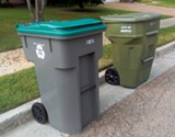 The new recycling bins are the - same size as city trash bins. - CHRIS SHAW