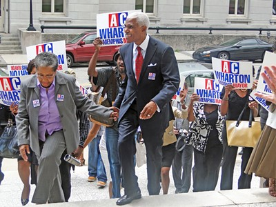 The Whartons, with supporters, arrive at the Election Commission Thursday - JB