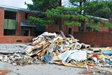 BIANCA PHILLIPS - This trash pile sits in front of a blighted apartment complex in Frayser.