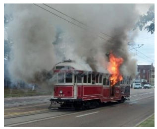 Trolley No. 452 in flames last year on the I-240 overpass.