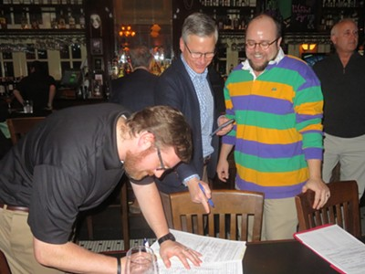 Congressional candidate John Boatner (r) beams as Jesse Huseth signs his qualifying petition at Owen Brennan's Restaurant, while  Tom Richgels waits his turn. - JB