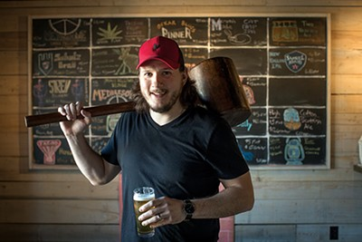 Kevin Eble hefts a giant mallet and a hand-crafted pint at Hammer and Ale.