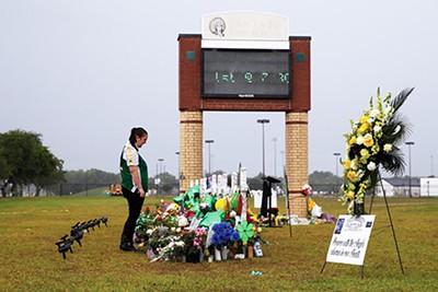 Santa Fe High School student Sierra Dean mourns the death of her friends killed in a recent shooting. - REUTERS / LOREN ELLIOTT