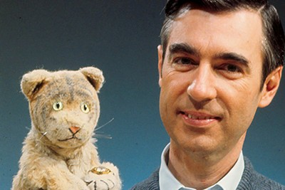 Daniel Tiger (left) and Fred Rogers, star of Mr. Rogers' Neighborhood
