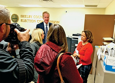 Election officials facing off with the media. - JACKSON BAKER