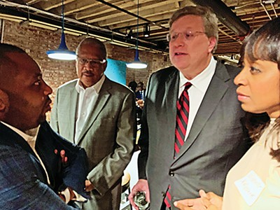 Mayor Jim Strickland at year-end reception with - (l to r) School Board member Kevin Woods, state Representative Larry Miller, and School Board member Michelle McKissack. - JACKSON BAKER