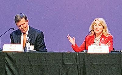 Paul Rose (left) and Heidi Shafer speak at a debate in Bartlett. - JACKSON BAKER