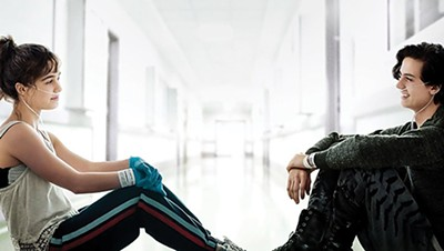 Haley Lu Richardson (left) and Cole Sprouse should actually be staying six feet apart in the new high school romance Five Feet Apart.