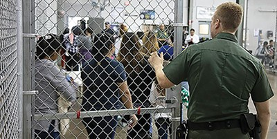 Children line up in a refugee detention center. - IMMIGRATION AND CUSTOMS ENFORCEMENT