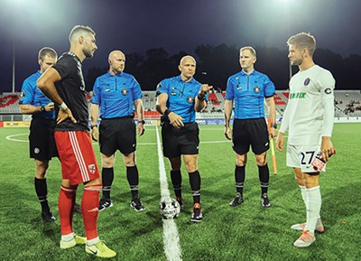 Stand-in 901 FC captain Cam Lindley, right, contests the coin toss against Loudon United captain Kyle Murphy - COURTESY LOUDON UNITED FC