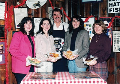 Thomas Boggs (center) with Huey's family - PHOTOGRAPHS COURTESY OF HUEY'S