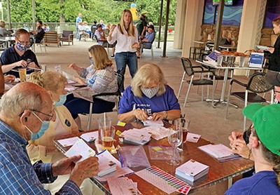 Reflecting a confidence that the U.S. Postal Service is equal to the task, District 83 state House candidate Jerri Green oversees a postcard-writing party. - JACKSON BAKER