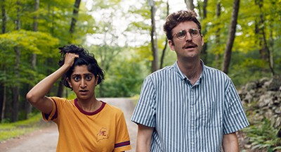 Invasion of the attention snatchers — Sunita Mani (left) and John Reynolds star as internet-savvy millennial lovebirds trying to unplug and recalibrate in Save Yourselves!