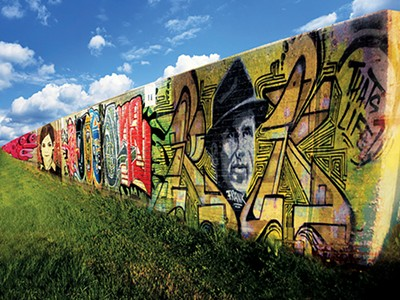 A portion of the Chelsea floodwall has already been painted by graffiti artists.
