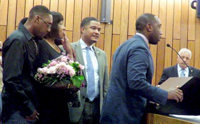 The family of late civil rights icon and National Civil Rights Museum founder D'Army Bailey acknowldged the Shelby County Commission's vote on Monday to rename the Shelby County Courthouse in his honor. From left: son Merritt Bailey, wife Adrienne Bailey, Commission chair Justin Ford, son Justin Bailey. At right is Commissioner Terry Roland, sponsor of the re-naming resolution. - JACKSON BAKER