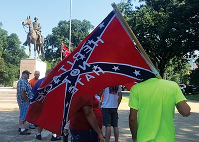 Confederate supporters at a rally on Saturday - TOBY SELLS