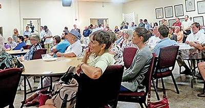 Council races attracted more than the usual amount of attention this year. Here a crowd at Trinity United Methodist Church followed a debate involving seven candidates running for an open 5t6h District seat. - JACKSON BAKER