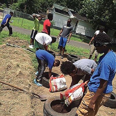 901 Evolution works on a community garden.
