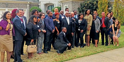 Drawing a crowd of local and statewide Democrats at a party fund-raiser over the weekend was visiting U.S. Senator Cory Booker (D-NJ). Booker is the tall, balding fellow behind Mayor AC Wharton. - JACKSON BAKER