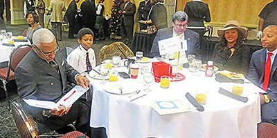 Sitting uneasily at the same table for the annual Myron Lowery prayer breakfast on January 1, 2015 were future antagonists Mayor A C Wharton (left) and Jim Strickland (in center). At far right is Council candidate Mickell Lowery, who would be upset in a Council race by underdog Martavius Jones.