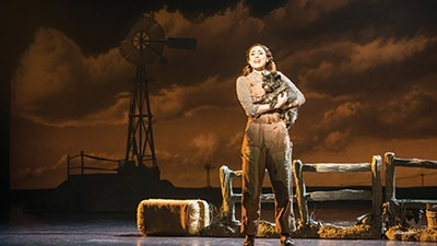 """Sarah Lasko as Dorothy and Nigel as Toto in """"Over the Rainbow"""""""