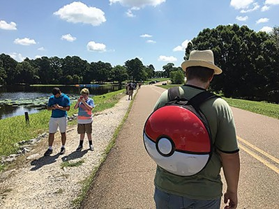 Pokémon Go players capture beasts at Shelby Farms Park.