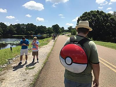 Pokémon Go players capture beasts at Shelby Farms Park.