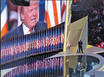 Standing before an array of flags, presidential candidate Donald Trump addresses the RNC. - JACKSON BAKER