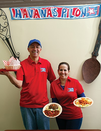 Pedro Pena and Marialys Gonzalez show off their delicious dishes.