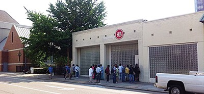 A line forms outside Hospitality Hub's offices.
