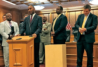 Memphis State Senator Lee Harris, at microphone, takes issue - with the GOP leadership as (l to r) state Reps. Antonio Parkinson, - G.A. Hardaway, and Joe Towns, all of Memphis, and state - Senator Jeff Yarbro of Nashville wait their turn.