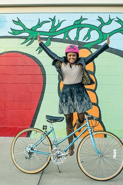 Roshun Austin displays serious skill — and enthusiasm — for safe cycling. - JUSTIN FOX BURKS