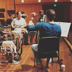 Musical director Robert Moody rehearses the Sabar Concerto with Senegalese drummers - MSO