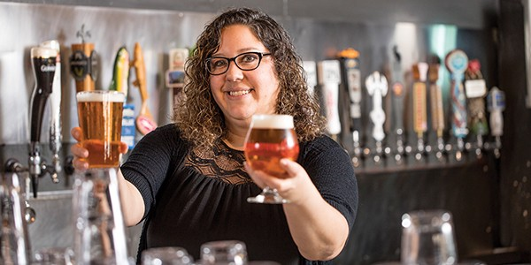 "Tessa Pascover celebrates the ""hand-crafted beer revolution"" at Young Avenue Deli."