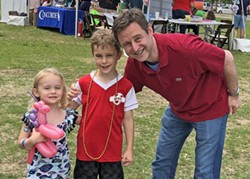 "Paul Morris, another Council hopeful, with children on grounds of Tiger Lane during Rotary's ""Cafe du Memphis"" - JB"