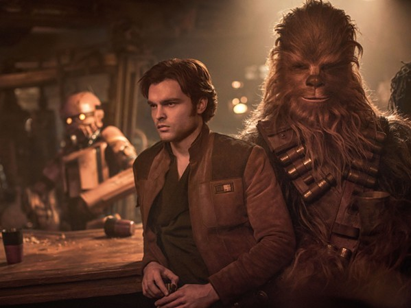 Alden Ehrenreich as Han Solo and Joonas Suotamo as Chewbacca