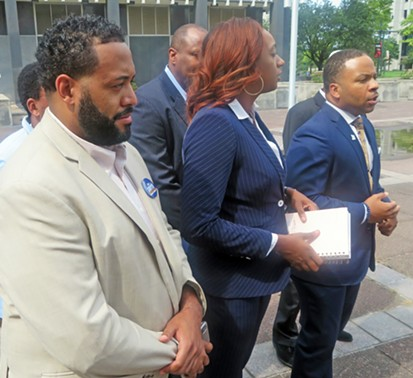 Shelby County Democratic chairman Corey Strong (right) and other Democrats announcing lawsuit at Friday press conference - JB