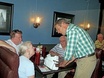 Gubernatorial candidate Lee works the room at Arlington's Legacy Grill. - JB