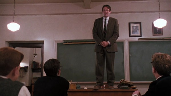 "Robin Williams in the famous desk scene from 1989's ""Dead Poets Society."" - CINEMA FANATIC"