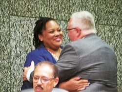 Commissioner-elect Tami Sawyer, a Democrat, is welcomed by GOP Commissioner Mark Billingsley.