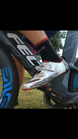 The SUV's tire allegedly rubbed the shoe of this cyclist, leaving black marks on his shoe. - TULIO BERTORINI/MEMPHIS HIGHTAILERS FOUNDATION