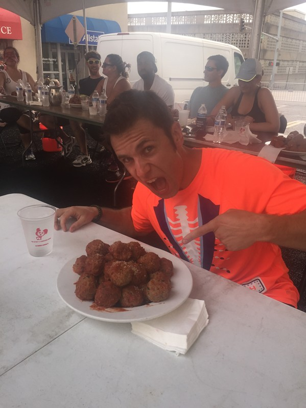 Brett Healey, a bonafide power eater, wins first place  - again - in the meatball eating contest at Madison Ave. Fest. - MICHAEL DONAHUE