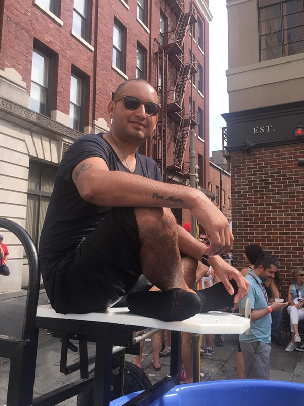 Ramon Vazquez during his shift at the Dunk Tank at Monroe Ave. Festival - MICHAEL DONAHUE