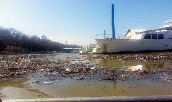 Trash floating in McKellar Lake in 2014.