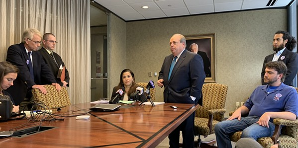 Attorney Randall Fishman backgrounds reporters on election suit as plaintiffs look on. - JB