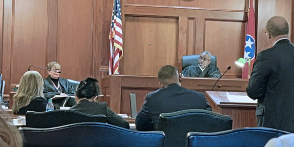 Chancellor JoeDae Jenkins listens as Election Commission attorney John Ryder (right) questions county Election Administrator Linda Phillips on voting suit. - JB