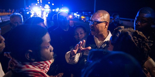 Michael Rallings with crowd during protest - BRANDON DILL