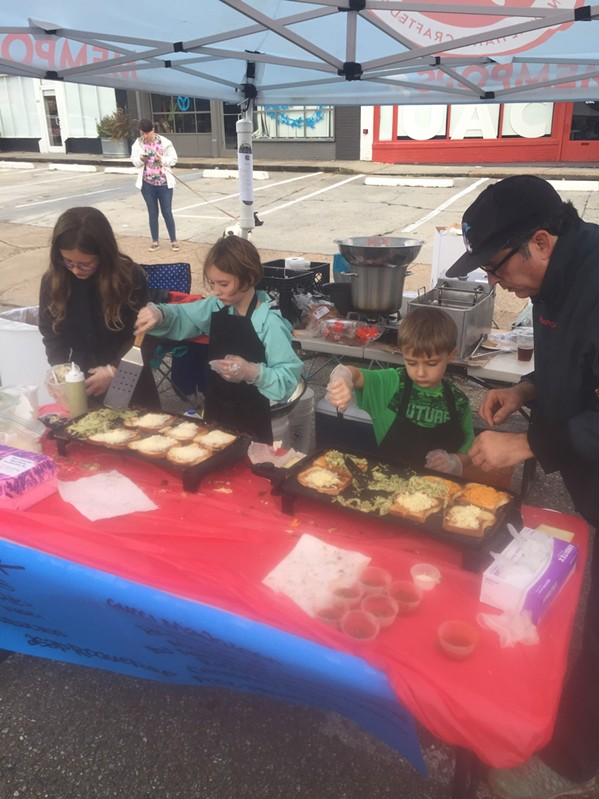 Young people manned the Mempops grilled cheese booth. - MICHAEL DONAHUE