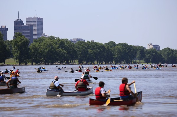 Paddlers push their boats down the Mississippi River during a running of the Outdoors Inc. Canoe and Kayak Race. - JOE ROYER